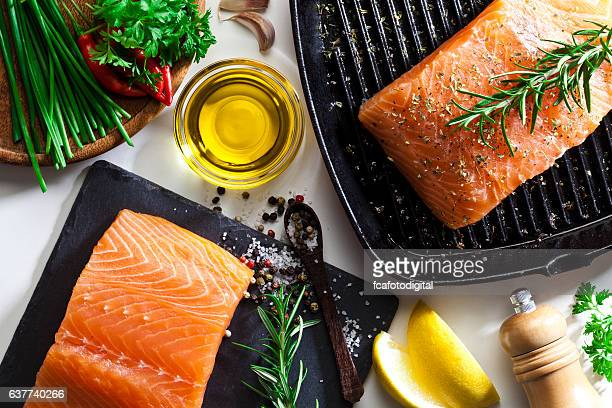 raw salmon steak - olive oil stock pictures, royalty-free photos & images
