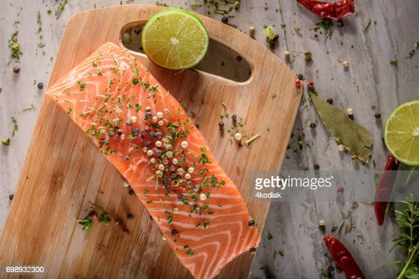 Raw Salmon Steak with Sea Salt and Spices, Herb