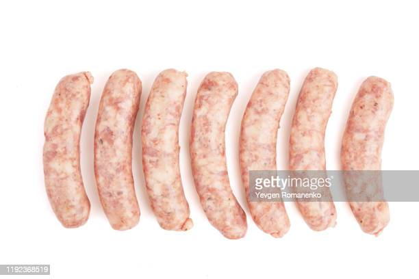 raw sausage isolated on white background - sausage stock pictures, royalty-free photos & images