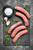 Raw Sausages on Slate Overhead View