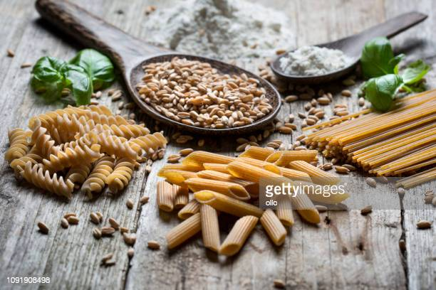 raw spelt pasta - wholegrain stock pictures, royalty-free photos & images