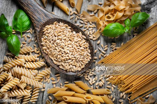 raw spelt pasta - whole wheat stock pictures, royalty-free photos & images