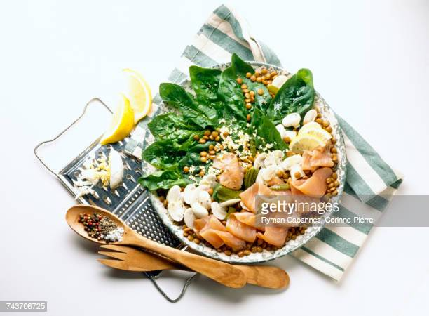 raw spinach and smoked salmon salad - raw food diet stock pictures, royalty-free photos & images
