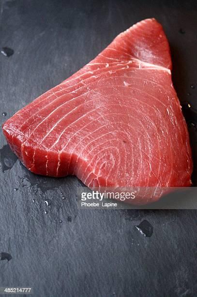 Raw Tuna steak on slate
