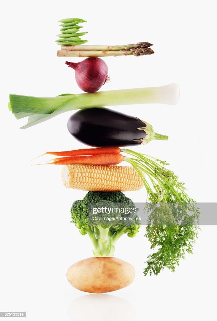 Raw vegetables balancing : Stock Photo