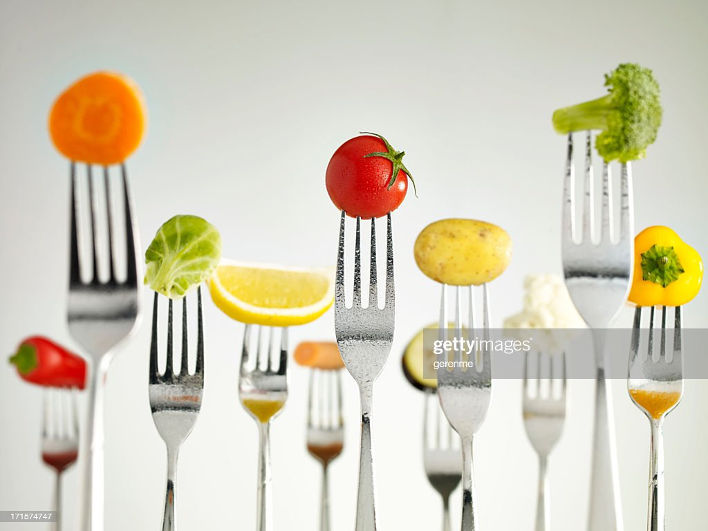 Raw vegetables On Forks : Stock Photo