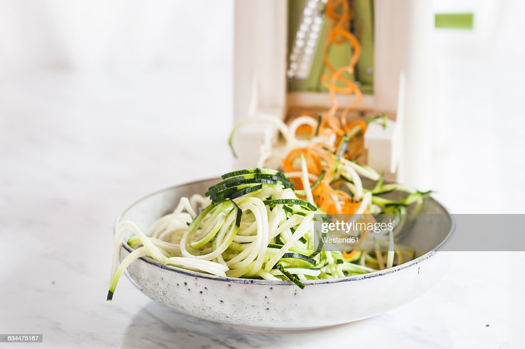 raw zucchini and carrot spaghetti cut with spiral slicer stock foto getty images. Black Bedroom Furniture Sets. Home Design Ideas