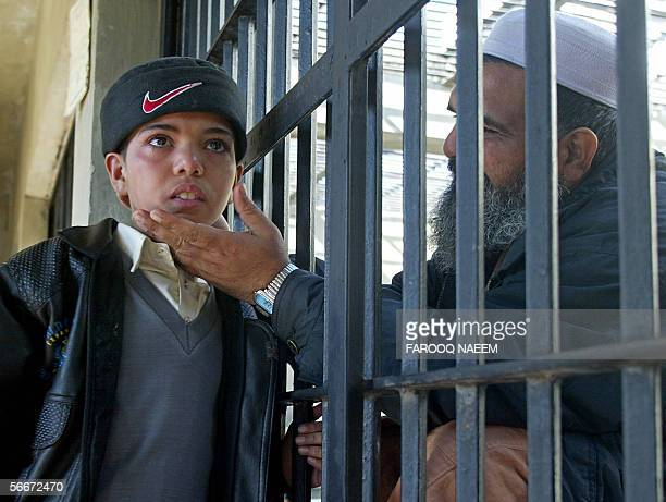 A Pakistani boy weeps as he meet his imprisoned father Aurangzeb at his cell in Adyala Jail in Rawalpindi 26 January 2006 Due to slow court...