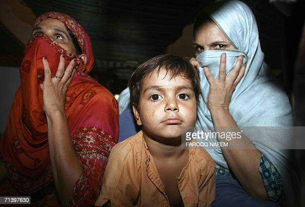 A Pakistani child sits with her mother prisoner at the Adiala Jail in Rawalpindi 08 July 2006 Pakistan's President Pervez Musharraf amended 07 July a...