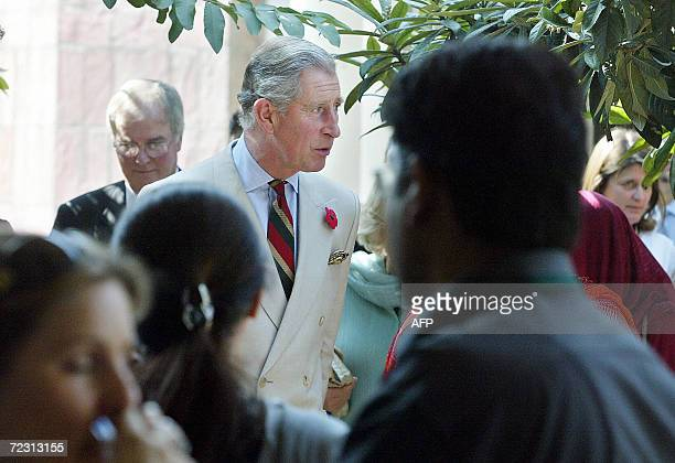 Britain's Prince Charles walks amidst students during a visit to Fatima Jinnah University in Rawalpindi 31 October 2006 Crowds of students cheered...