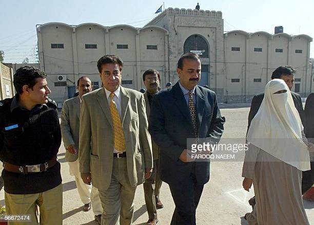 Chairman of Pakistan's Parliamentarians Commission for Human Rights Riaz Fatyana is accompanied by fellow legislators as he walks in the grounds of...