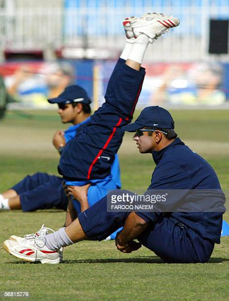 Indian cricket captain Rahul Dravid and Murali Kartik exercise during a practice session at the Pindi Cricket stadium in Rawalpindi 10 February 2006...