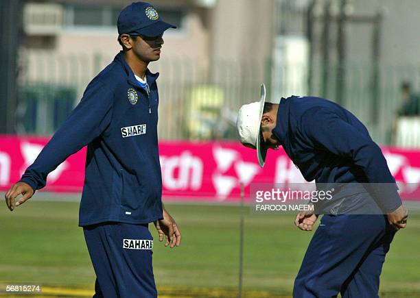 Indian cricket captain Rahul Dravid shares a light moment with Virender Sehwag during a practice session at the Pindi Cricket stadium in Rawalpindi...