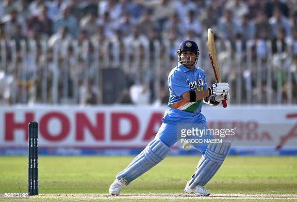 Indian cricketer Sachin Tendulkar watches the ball after playing a shot during the second One Day International match between Pakistan and India at...