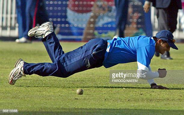 Indian cricketer Suresh Kumar Raina drops a catch during a practice session at the Pindi Cricket stadium in Rawalpindi 10 February 2006 Pakistani...