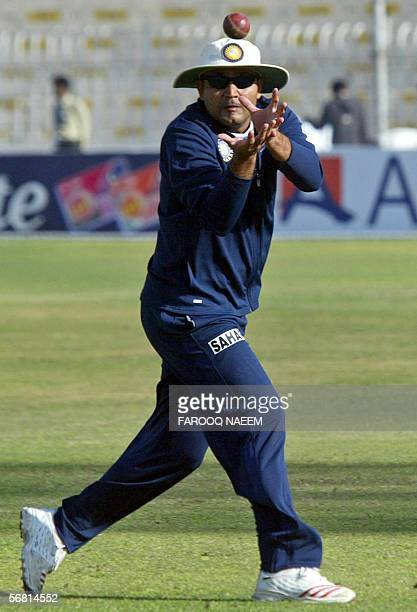 Indian cricketer Virender Sehwag catches the ball during a practice session at the Pindi Cricket stadium in Rawalpindi 10 February 2006 Pakistani...