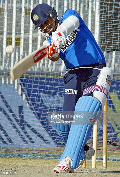 Indian cricketer Virender Sehwag plays a shot during a practice session at the Pindi Cricket stadium in Rawalpindi 10 February 2006 Pakistani fast...