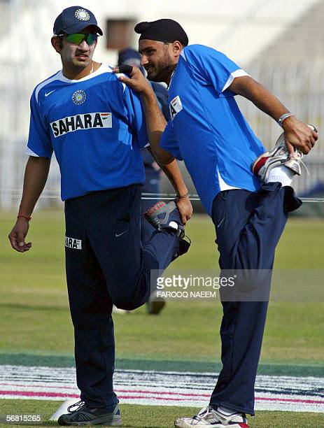 Indian cricketers Gautam Gambhir and Harbhajan Singh stretch during a practice session at the Pindi Cricket stadium in Rawalpindi 10 February 2006...