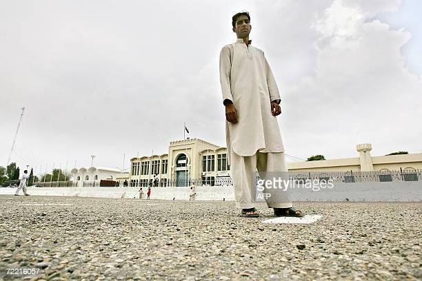 Mohammad Saeed the cousin of British national Mirza Tahir Hussain waits outside Adiala Jail in Rawalpindi 19 October 2006 after coming to visit his...