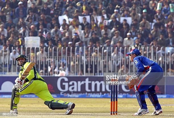 Pakistani batsman Shahid Afridi plays a sweep shot as England wicketkeeper Geraint Jones looks on during the fourth One Day International cricket...