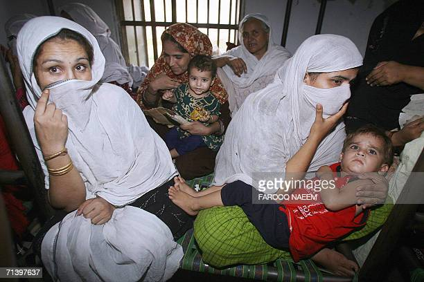 Pakistani children sit on the laps of their mothers prisoners at the Adiala Jail in Rawalpindi 08 July 2006 Pakistan's President Pervez Musharraf...