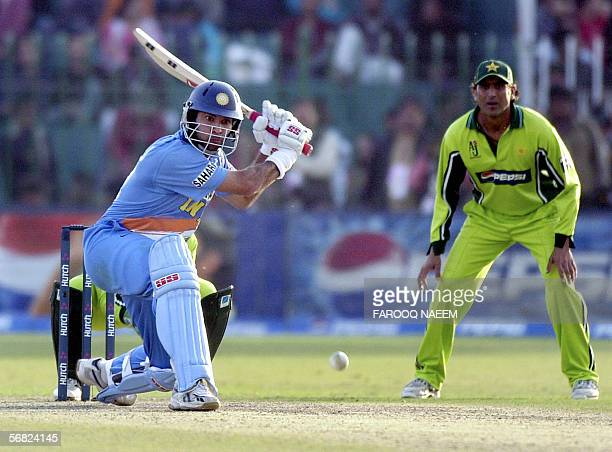 Pakistani cricketer Younis Khan watches Indian batsman Yuvraj Singh play a shot during the second One Day International match between Pakistan and...