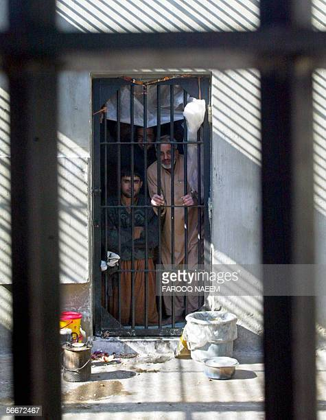 Pakistani prisoners facing murder charges look through the bars of their cell at Adyala Jail in Rawalpindi 26 January 2006 Due to slow court...
