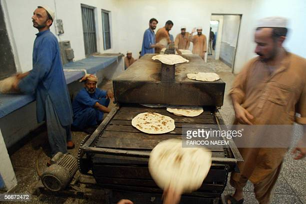Pakistani prisoners prepare bread in the kitchens of Adyala Jail in Rawalpindi 26 January 2006 Due to slow court procedures it usually takes between...