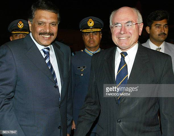 Pakistani Religious Minister EjazulHaq walks with Australian Prime Minister John Howard upon his arrival at Chaklala Air base in Rawalpindi 21...