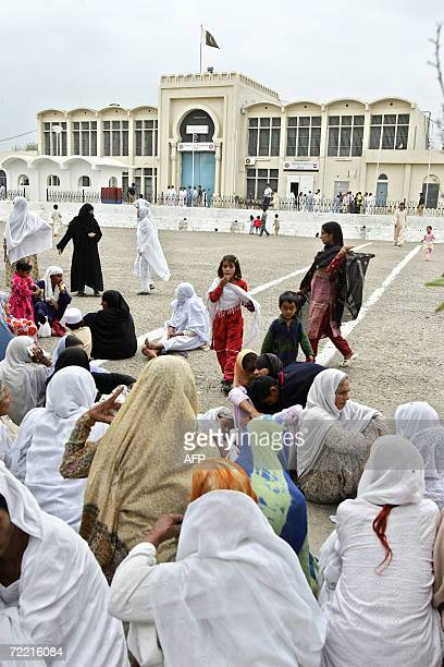 Pakistani visitors who come to see their jailed loved ones wait in the premises of Adiala Jail in Rawalpindi 19 October 2006 where a British national...