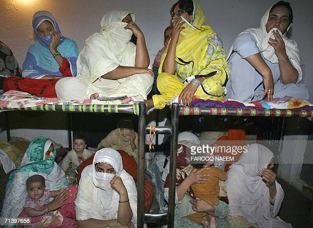 Pakistani women prisoners sit in a cell with their children at the Adiala Jail in Rawalpindi 08 July 2006 Pakistan's President Pervez Musharraf...