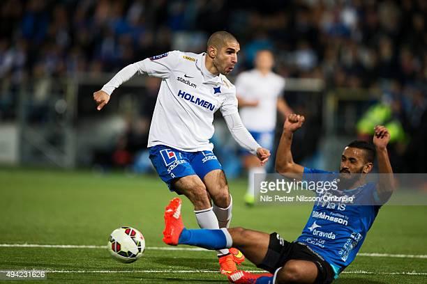 Rawes Lawan has a shot blocked by Junes Barny during the IFK Norrkoping vs Halmstad BK - Allsvenskan match at Nya Parken on October 25, 2015 in...
