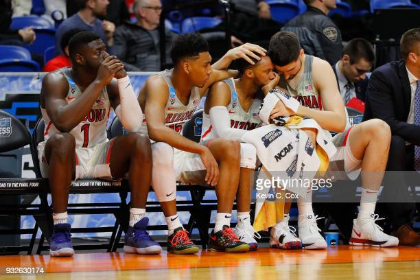 Rawle Alkins Allonzo Trier Parker JacksonCartwright and Dusan Ristic of the Arizona Wildcats react on the bench in the second half against the...