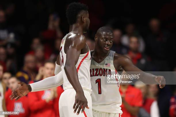 Rawle Alkins and Deandre Ayton of the Arizona Wildcats celebrate after winning in college basketball game against the Connecticut Huskies at McKale...