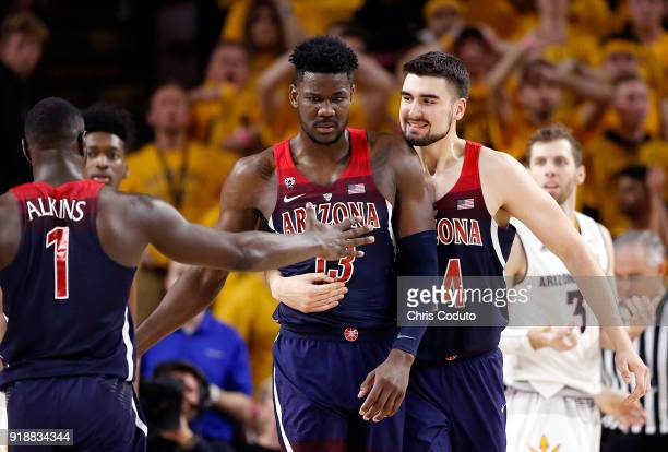 Rawle Alkins and Dusan Ristic react with teammate Deandre Ayton of the Arizona Wildcats after a basket during the second half of the college...