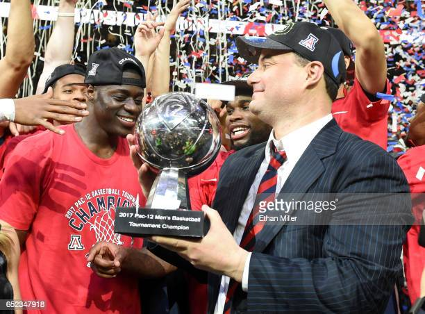 Rawle Alkins and head coach Sean Miller of the Arizona Wildcats celebrate with the trophy after defeating the Oregon Ducks 8380 to win the...