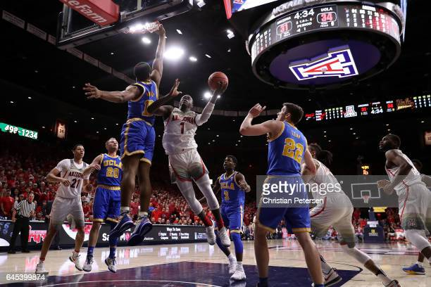 Rawle Alkins of the Arizona Wildcats attempts a shot against Ike Anigbogu of the UCLA Bruins during the first half of the college basketball game at...