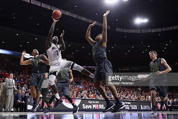 Rawle Alkins of the Arizona Wildcats attempts a shot over John Edgar Jr #11 of the UC Irvine Anteaters during the first half of the college...