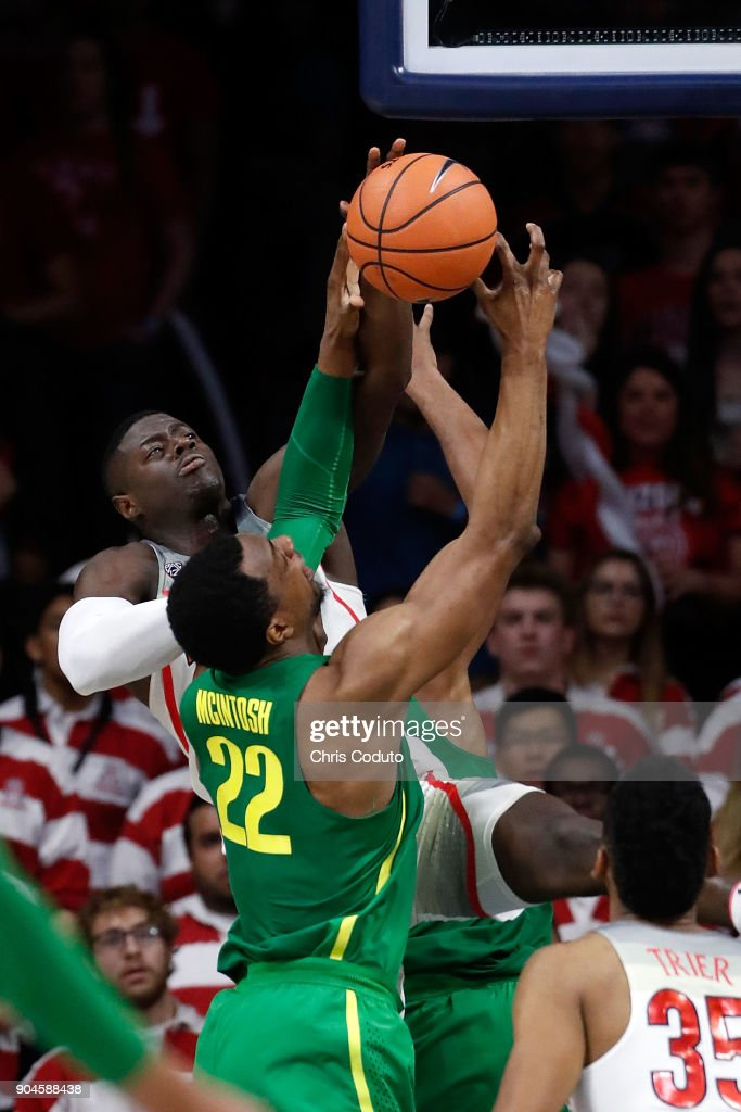 Rawle Alkins #1 of the Arizona Wildcats blocks a shot by MiKyle McIntosh #22 of the Oregon Ducks during the second half of the college basketball game at McKale Center on January 13, 2018 in Tucson, Arizona. The Wildcats beat the Ducks 90-83.