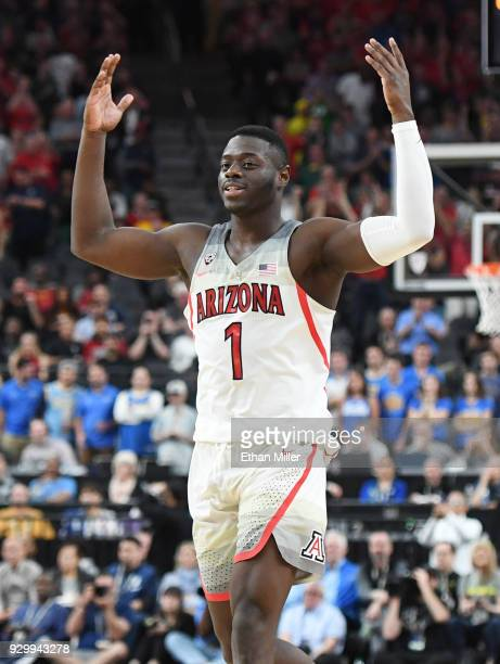 Rawle Alkins of the Arizona Wildcats celebrates on the court near the end of a semifinal game of the Pac-12 basketball tournament against the UCLA...