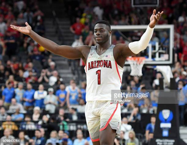 Rawle Alkins of the Arizona Wildcats celebrates on the court near the end of a semifinal game of the Pac12 basketball tournament against the UCLA...