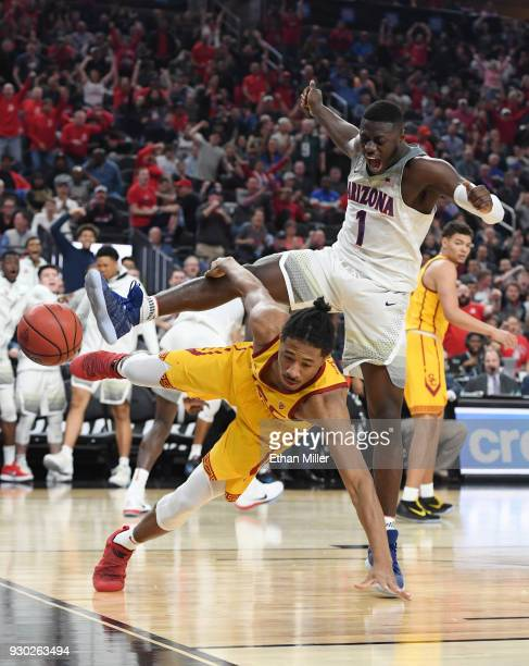 Rawle Alkins of the Arizona Wildcats dunks against Elijah Stewart of the USC Trojans during the championship game of the Pac12 basketball tournament...