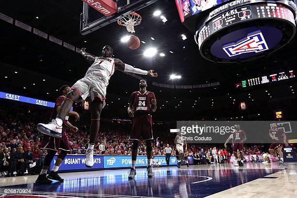 Rawle Alkins of the Arizona Wildcats dunks the ball during the first half of the NCAA college basketball game against the Texas Southern Tigers at...