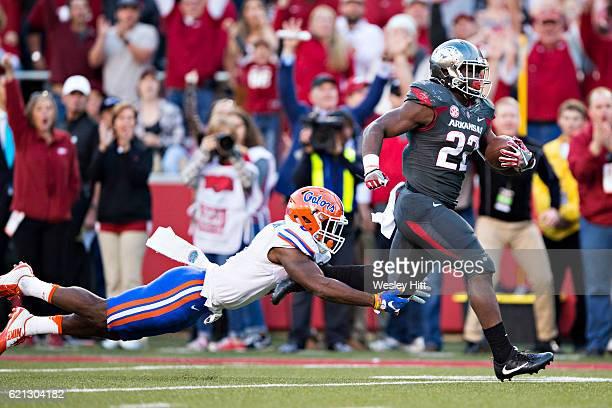 Rawleigh Williams III of the Arkansas Razorback runs the ball for a touchdown and outruns Nick Washington of the Florida Gators at Razorback Stadium...