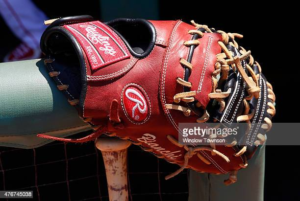 A Rawlings baseball glove is seen at the Minnesota Twins dugout before the game between the Boston Red Sox and the Minnesota Twins at Fenway Park on...