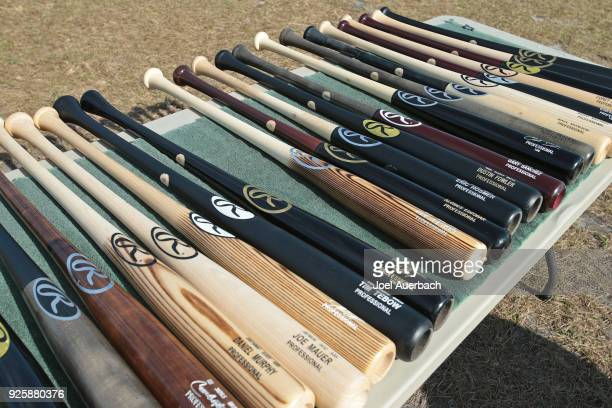 Rawlings bats are displayed for the Houston Astros on the back field prior to the spring training game against the Boston Red Sox at The Ballpark of...