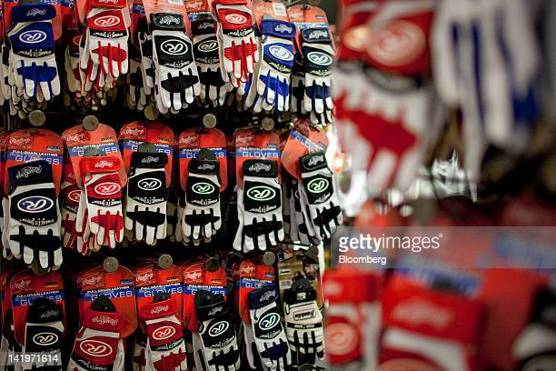 Rawlings Sporting Goods Company Inc baseball batting gloves are displayed for sale at a Modell's retail location in Times Square in New York US on...