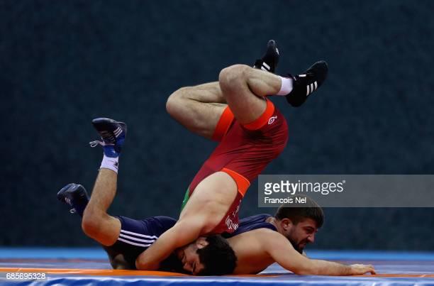 Raxmatulla Murtazali Muslimov of Azerbaijan competes against Zafar Dama of Turkey in the Mens Freestyle Wrestling 70 kg Quater Final during day nine...
