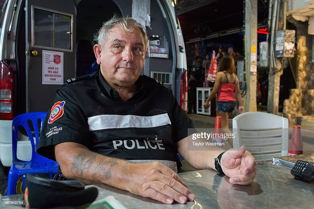 Ray Aldridge, a member of FTPA, mans a mobile center for Tourist Police on Pattaya's Walking Street on July 31, 2014 in Pattaya, Thailand. Since 2002, members of the Foreign Tourist Police Assistants (FTPA) of Pattaya have been assisting local police on Walking Street, Pattaya's main nightlife area. Members of the FTPA carry handcuffs, batons, and pepper spray, and are charged primarily with assisting foreign visitors and the Thai police, as well as breaking up fights and catching thieves.
