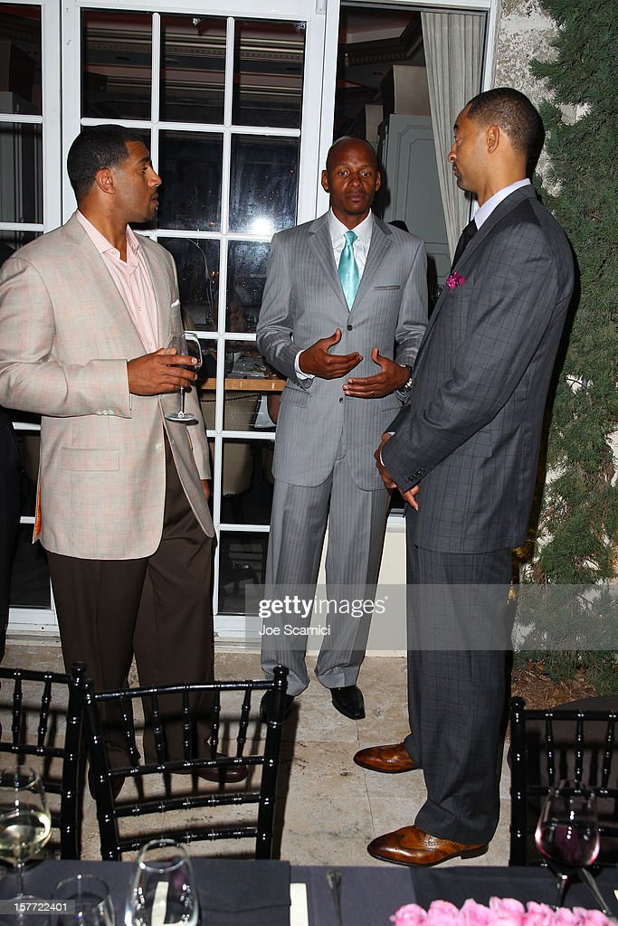 Ray Allen (C) and Juwan Howard (R) attend the Haute Living and Roger Dubuis dinner hosted By Daphne Guinness at Azur on December 5, 2012 in Miami Beach, Florida.
